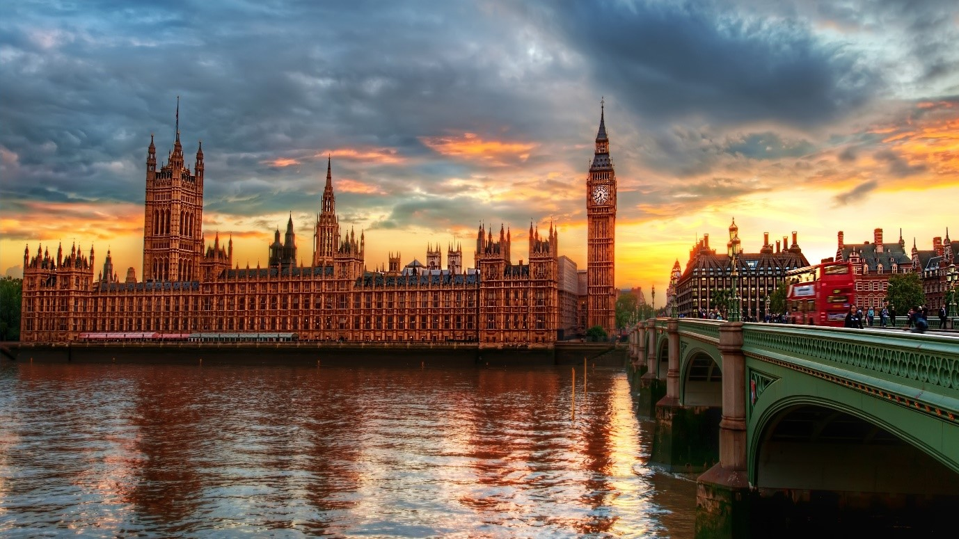 houses of parliament, big ben and river thames at sunset